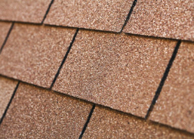 a close up of an overlapping house roofing
